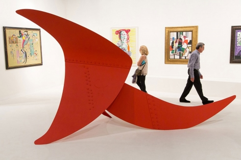 Installation view of Art Basel | Miami Beach 2013, booth B01 featuring a large scale sculpture by Alexander Calder composed of three metal sheets all painted in red in shape of slightly curvy triangular, of large, medium and smaller sizes, all connected together, the sculpture is called, Brontosaurus and was made in 1970. The materials are, painted metal stabile, the dimensions are  213 x 152 x 365.8 cm. (84 x 60 in. x 144 inches). Photography by Karen Fuchs.  © 2018 Calder Foundation, New York / Artist Right Society (ARS), New York. ©Helly Nahmad Gallery NY.