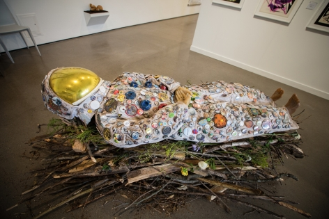 she changed sunset into sunrise (astronaut, female, 8 days pregnant), 2016-18, Found wood, firewood, fresh flowers, astronaut, beeswax, custom pin buttons, earth from the catskills, life