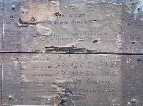 "Exhibition label on ""River Scene"" by Edward Dufner."