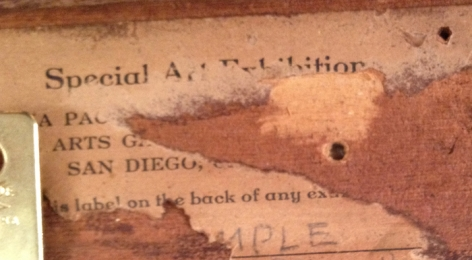 Label fragment on verso of Clown Reading.