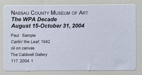 """Nassau County Museum label on """"Cartin' the Leaf"""" by Paul Sample."""