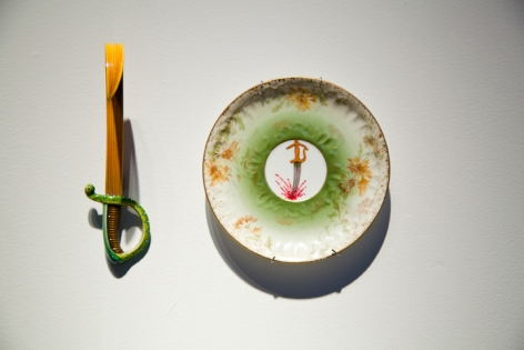 Adeela Suleman THANK YOU FOR YOUR SERVICE 3 2014 Found porcelain plate with enamel paint and hand-painted dagger Plate: 5 x 5 in. / Dagger: 6 x 2 x 4 in.