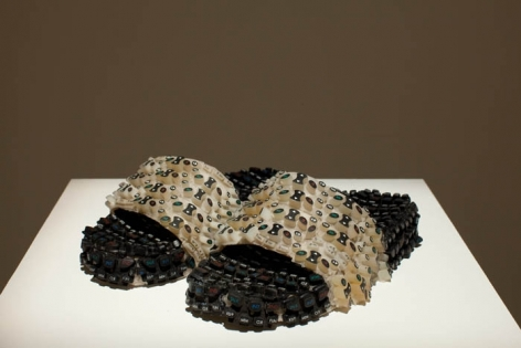 Amna Ilyas UNTITLED 1 (Slippers) 2009 Fibreglass, mobile key pads 3.5 x 11 x 10 in.