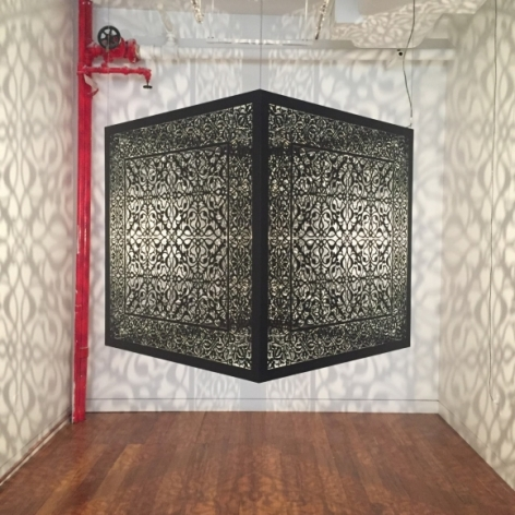 Anila Quayyum Agha Shimmering Mirage (Ed. Of 6) 2016 Laser-cut black steel and bulb ​36 x 36 x 36 in.