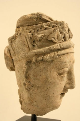 Head of a Devotee Ancient Region of Gandhara, Kushan Period 2nd/3rd Century Stucco with traces of pigment Height: 9 in.  NFS