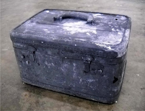 John Jurayj UNTITLED (WOMAN'S TRAVEL CASE) 2010 Cast gunpowder and plaster 8.5 x 14 x 10 in.  NFS