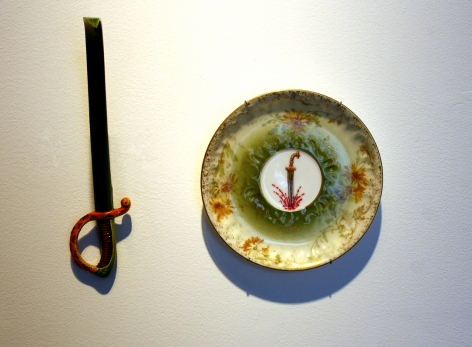 Adeela Suleman THANK YOU FOR YOUR SERVICE 4 2014 Found porcelain plate with enamel paint and hand-painted dagger Plate: 5 x 5 in. / Dagger: 7 x 2 x 4.5 in.