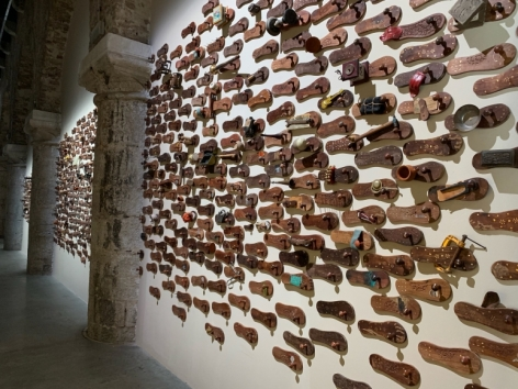G. R. Iranna  Naavu (We Together)  2012  Wood and mixed media  Dimensions variable, site specific  500-650 padukas