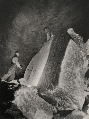 Harold Haliday Costain, Drilling a 60-ton Rocksalt Block, Avery Island, Louisiana, 1934. One man to the left drilling into the block while another stands above.