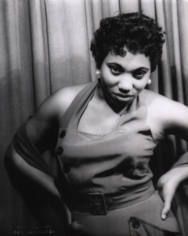 Carl Van Vechten, Leontyne Price in Porgy & Bess, 1953. Subject poses against a curtain with hands on hips, looking to the camera.