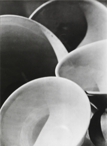 Paul Strand, Bowls, 1916. Four white bowls overlapping with dramatic shadows.