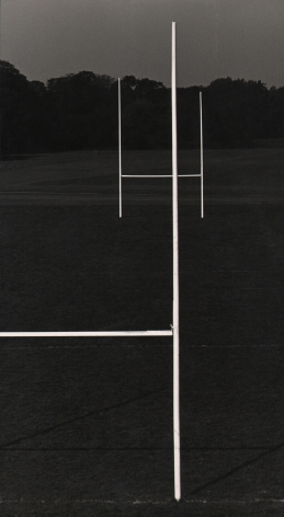 12. Michael O'Cleary, Winner, c. 1955–1961. Dark landscape with the frame divided by white goal posts.