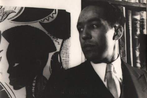 Carl Van Vechten, Langston Hughes, ​1932. Subject poses looking to the left beside a painting with the figure in the same pose.