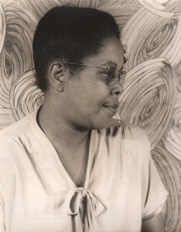 "06. Carl Van Vechten, Bertha ""Chippie"" Hill, ​1947. Bust-length portrait with the subject's head in profile, facing the right of the frame."