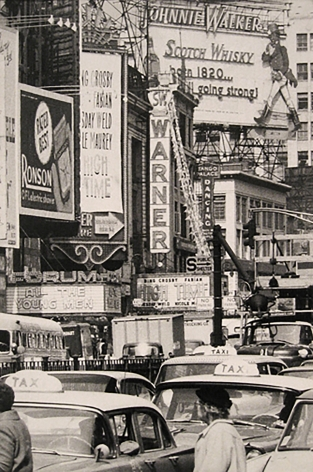 5. Caio Garrubba, Untitled, ​1960. Times Square street scene with various advertisements and marquees. Taxis and pedestrians in the street in the foreground.