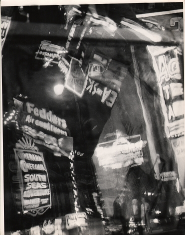 6. David Attie, Times Square, ​1958. Abstract, distorted composition of neon signs in Times Square.
