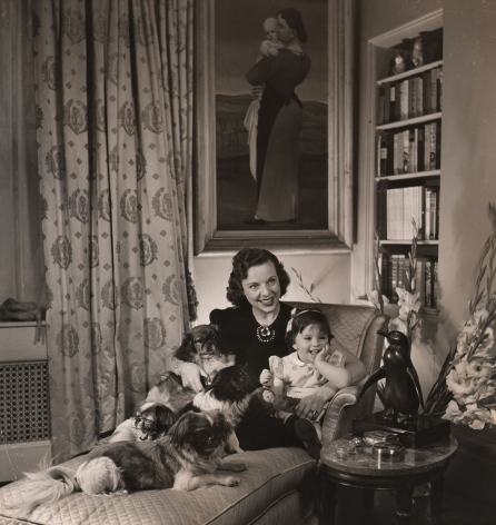 Louise Dahl-Wolfe, Mrs. Howard Dietz, Chairman of the Allied Relief Ball, 1942, A woman sits on a chaise with a small child and four small dogs.