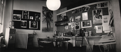 02. Anthony Barboza, My Studio, 10 West 18th Street, NYC, 1970s. Wide shot of a studio space with prints all over the two visible walls.