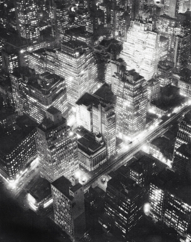 Berenice Abbott, Nightview, New York, c. 1932. Aerial, high-contrast night scene encompassing a few city blocks with buildings lit from inside.