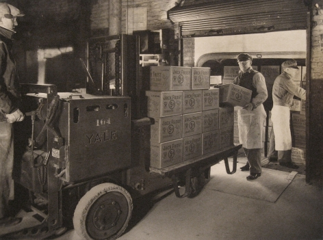 Harold Haliday Costain, Long Island City Plant, 1935. Three men load boxes onto a vehicle.
