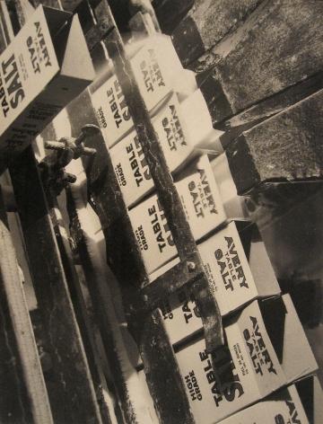 "Harold Haliday Costain, Filling Cartons, Island Salt Co. Brand, Avery Island, Louisiana, 1934. A machine fills ""Avery Table Salt"" boxes with salt."