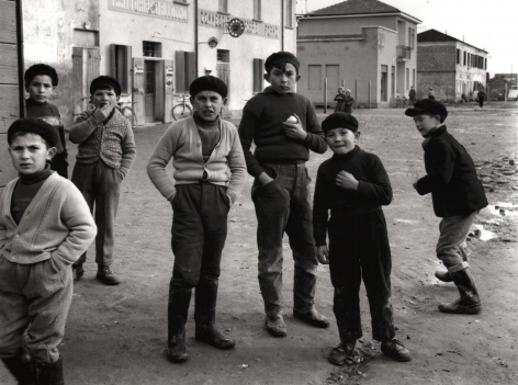 Nino Migliori, Delta People, 1958. Seven boys on the street looking to the camera.