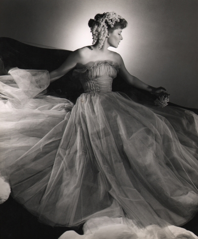 George Platt Lynes, Katharine Hepburn, c. 1946. Actress poses with flowing tulle gown and flowers in her hair, face turned to the right.