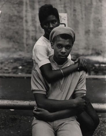 03. Beuford Smith, Lower East Side, 1968. A young seated couple; the young woman sits behind the young man with arms around his neck.