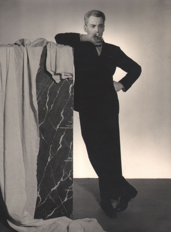 Jared French, George Platt Lynes, c. 1935. Full-body studio portrait with Lynes leaning against a shoulder-height block.