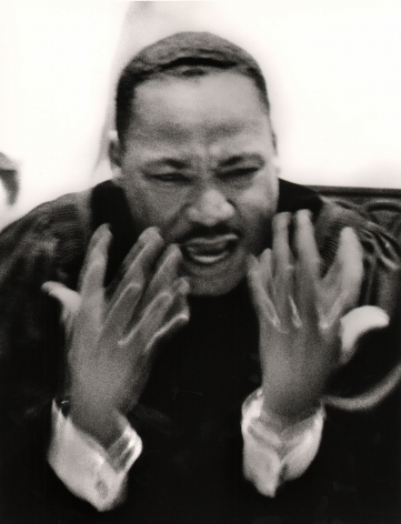 Flip Schulke, Martin Luther King, Jr. Preaching at Ebenezer Baptist Church, 1963. Subject is blurred in motion with hands gesturing in front of him.