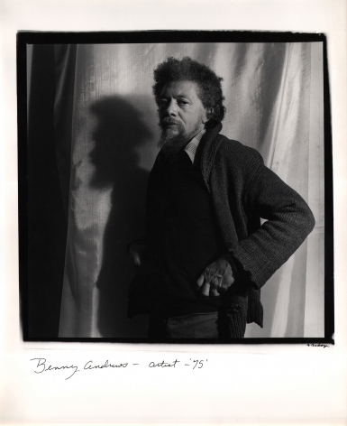 Anthony Barboza, Benny Andrews – Artist, 1975. Subject stands in the center of the square frame facing left with hands on hips against a shiny fabric background.