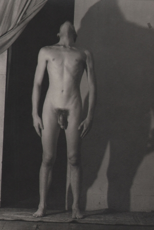 PaJaMa (Jared French), John Butler, ​1943. Nude male figure with head turned upward, a wide shadow cast on the wall behind him.