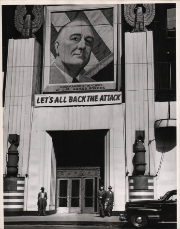 """Gordon Coster, Let's All Back the Attack, c. 1943. Mural above a building entrance with a portrait that reads """"Commander-in-Chief of Our Armed Forces - Let's All Back the Attack"""""""