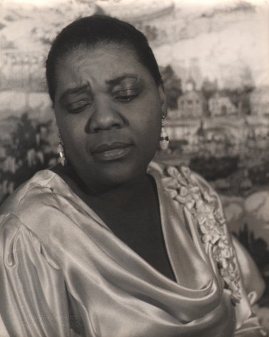 07. Carl Van Vechten, Bessie Smith, 1936. Bust-length portrait of the subject in silk with eyes downcast.