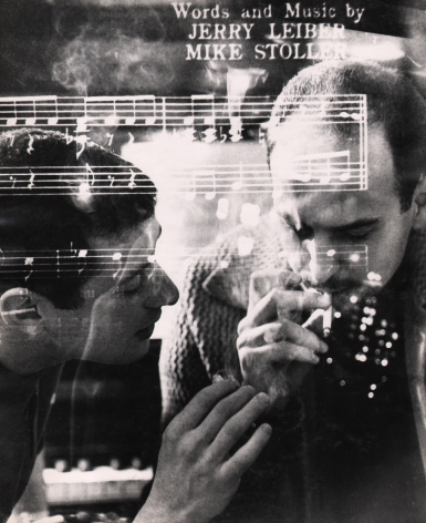 """04. David Attie, Jerry Leiber & Mike Stoller, n.d. Double-exposure photograph of two men smoking cigarettes, overlaid with sheet music featuring the words """"Words and Music by Jerry Leiber / Mike Stoller""""."""