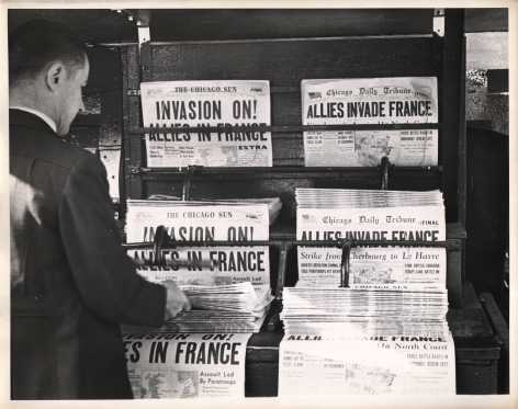 """Gordon Coster, Untitled, 1944. Newspaper display with headlines such as """"Allies Invade France"""" and """"Invasion On! Allies in France"""""""