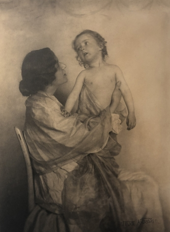 02. Gertrude Käsebier, Adoration, 1897. A seated woman in profile holds a small child upright on her lap.
