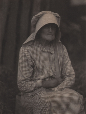 Doris Ulmann, Untitled (Woman in bonnet), ​1928–1934. Seated woman in checkered dress and large bonnet with arms crossed