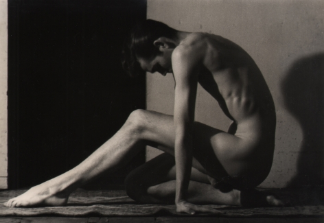 PaJaMa, John B., ​c. 1945. Nude male figure seated in profile facing left, back hunched, arms straight down to the floor, one leg beneath him and one extended out in front of him.