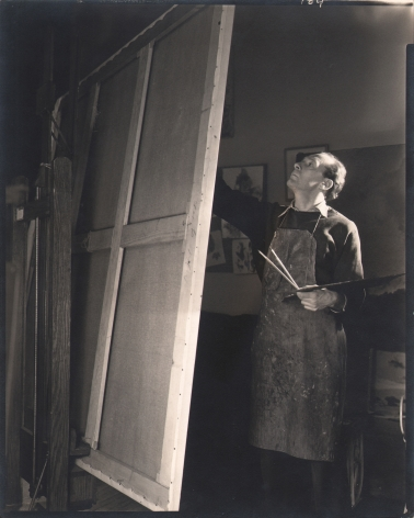 George Platt Lynes, Pavel Tchelitchew, n.d. Subject is standing before an easel, painting.
