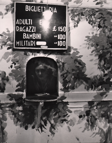 Alfredo Camisa, Botteghino del Circo, 1956. A woman peers out from a ticketing booth beneath a sign with ticket prices.