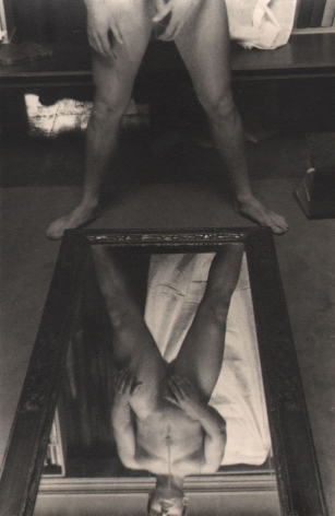 PaJaMa, Jensen Yow, ​c. 1945. Nude male figure standing above a mirror, feet spread to the mirror's bottom corners. Full body is seen in the reflection; only the lower body above.