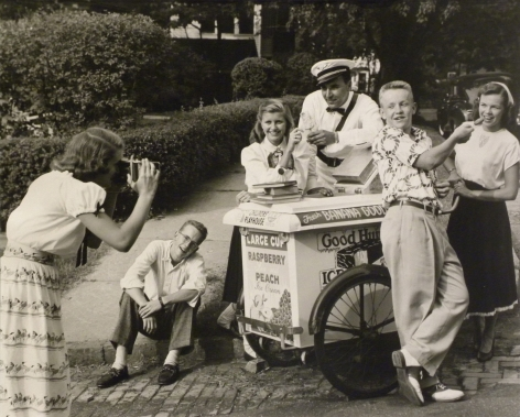 Ralph Bartholomew, Advertisement for Eastman Kodak, c. 1947. A group of teens poses around an ice cream cart with the male vendor as a young woman photographs them from the lower left of the frame.