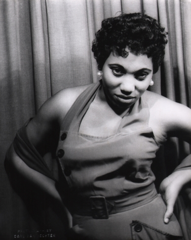 10. Carl Van Vechten, Leontyne Price in Porgy & Bess, 1953. Subject poses against a curtain with hands on hips, looking to the camera.
