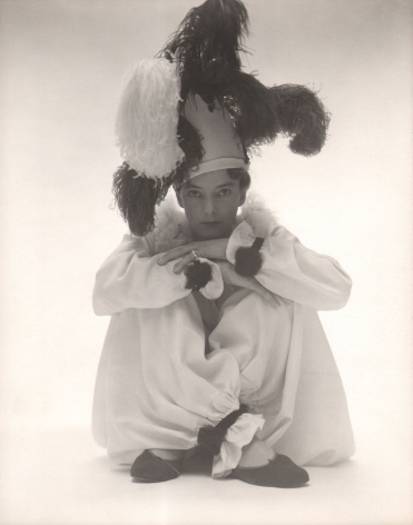 George Platt Lynes, Margaret French, c. 1940. Subject is seated on the studio floor in a clown costume.