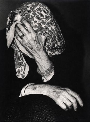 08. Mario Giacomelli, Verrà la morte e avrà i tuoi occhi, 1966–1968. High contrast image. Seated woman covers her face with a hand and kerchief.