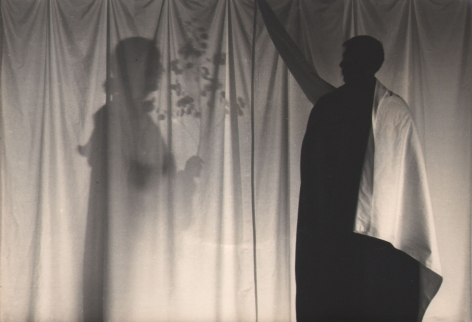 PaJaMa, Margaret French, Paul Cadmus, Provincetown, ​c. 1945. Two silhouettes on either side of a backlit white sheet. The left figure holds a small branch with leaves.