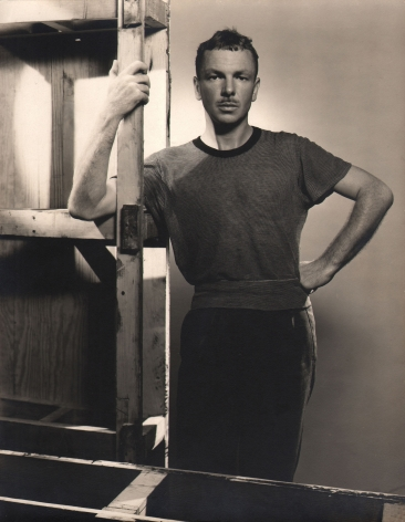 George Platt Lynes, Jared French, c. 1946. Subject stands behind and beside wooden supports.