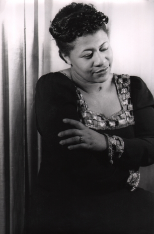 02. Carl Van Vechten, Ella Fitzgerald, 1940. Waist-up portrait of the singer, eyes downcast and arms crossed.