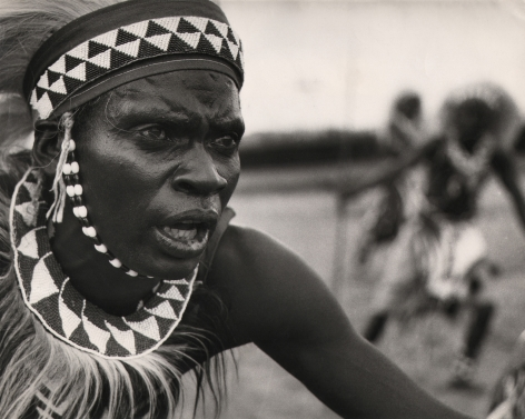 07. Derrick Knight, Watutsi Dancer, Ruanda Urundi, c. 1959. Close-up of the face of a traditionally costumed Watutsi dancer, looking off to the right of the frame.